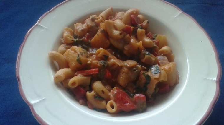 Banza pasta with creamy tomato sauce, red peppers, poblano pepper, shallots, pineapple and fresh basil