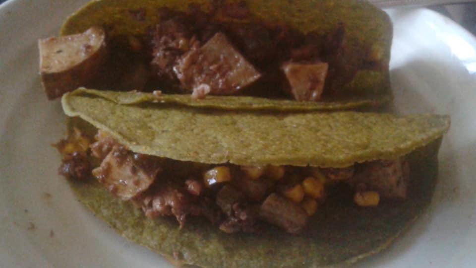 Potato, sardine, corn, red onion salad with dijon, agave, balsamic dressing in corn/spinach hard taco shells