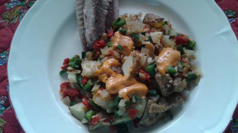 Healthy home fries with chipotle pine nut sauce and water packed sardines