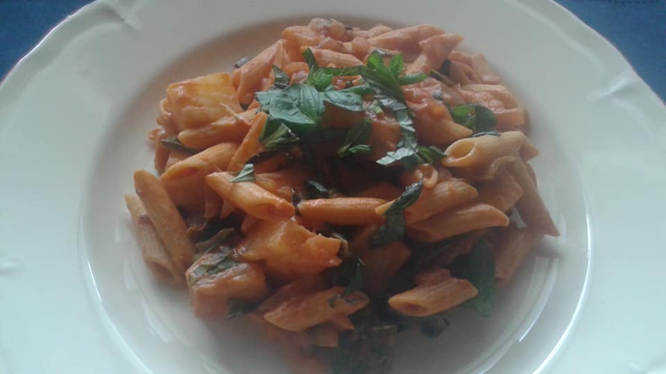 Penne with creamy tomato sauce, shallots, poblano peppers, pineapple and basil