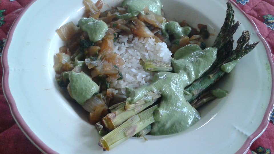 Braised baby bok choy and shallots with roasted asparagus and basmati rice. Topped with an oil free basil pesto.