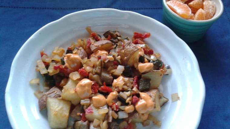 Homefried potatoes with shallots, sun dried tomatoes and poblano peppers topped with chipotle pine nut sauce and tangelos