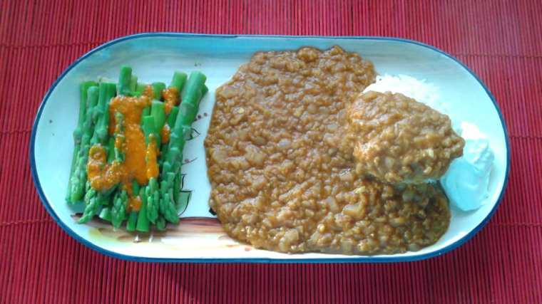 Misor wot (Ethiopian Red Lentils - made with Penzeys Berbere Seasoning), over rice with a bit of sour cream and asparagus with salsa on the side