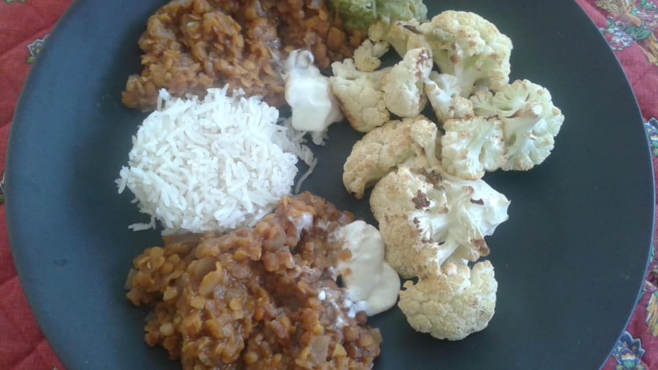 Roasted cauliflower, Ethiopian red lentils, basmati rice with guacamole and sour cream to cool the heat of the lentils