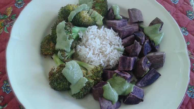 Roasted broccoli and purple sweet potatoes over basmati rice with oil free basil pesto
