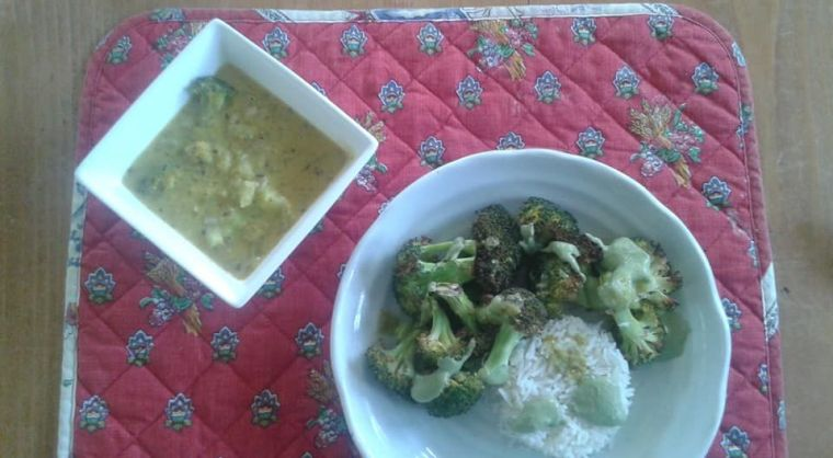 Roasted broccoli with no oil basil pesto and a side of rice with Corn, broccoli, shallot coconut milk soup