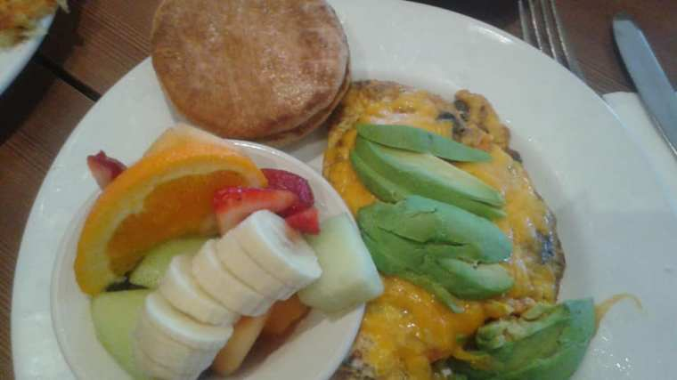 Easter treat: California omelette (with mushrooms., tomatoes and cheese topped with avocado), fresh fruit and buttered English muffin