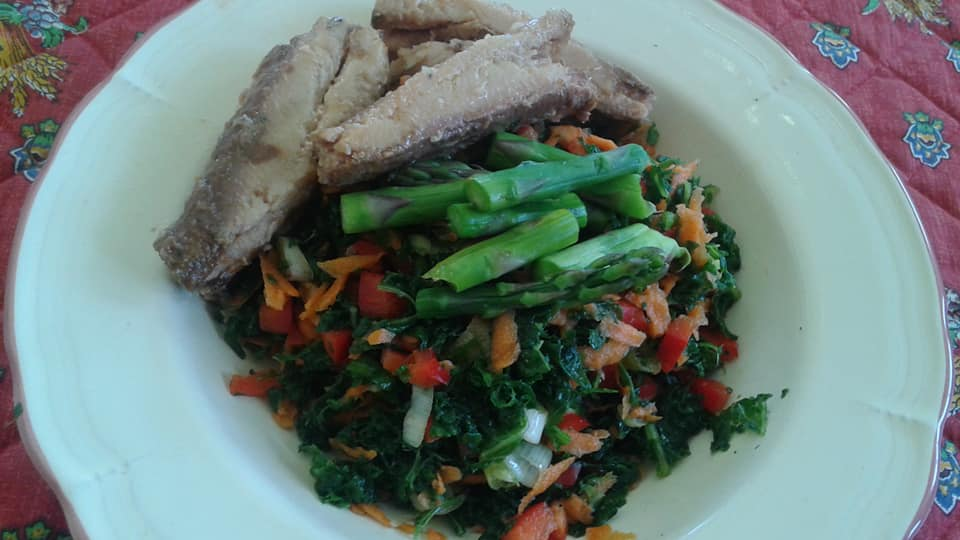 Massaged kale salad with shredded carrots, red peppers, green onions and asparagus. Digon, agave, balsamic dressing. Side of Sardines