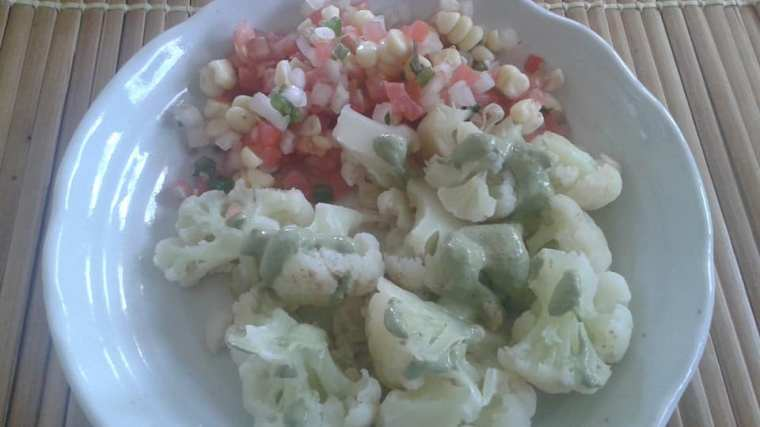 Steamed cauliflower topped with no oil basil pesto and a side of ;corn, tomato pico de gallo