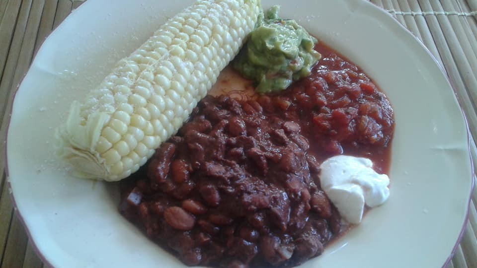 Game of Thrones fun: cocoa pinto beans, corn on the cob (seasoned with lime juice & salt), guacamole, crema and salsa