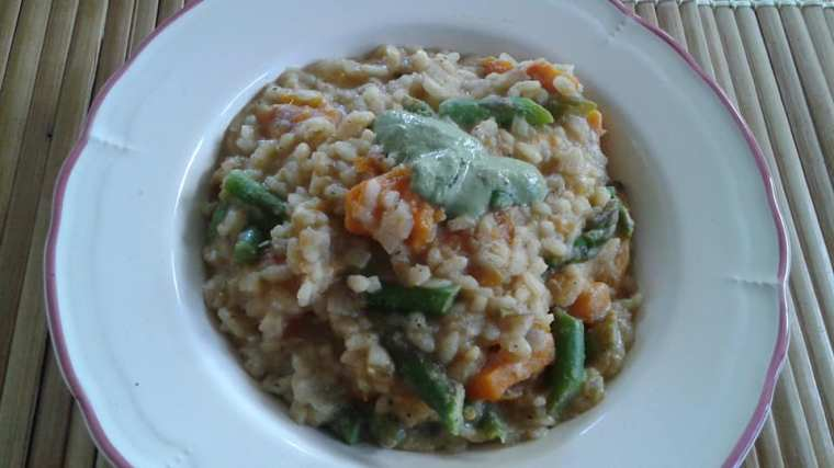 Butternut squash and asparagus risotto finished with Penzeys Brady Street Cheese Sprinkle, Miyokos Vegan Butter and Nutritional Yeast and No Oil Basil Pesto